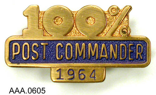 "This artifact is an American Legion Pin  of the ""1964 - Post Commander - 100%."" Donor's Remarks:  This pin most likely belonged to F. Joseph Hannon."