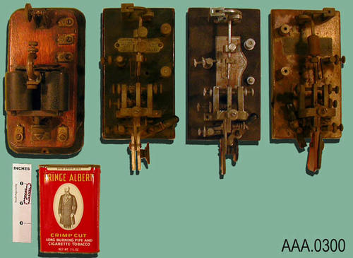 This artifact collection consists of one telegraphic receiving unit and three telegraph keys (bugs). Donor's Remarks:  A Prince Albert tobacco can put behind the receiving unit helped to amplify the sound.