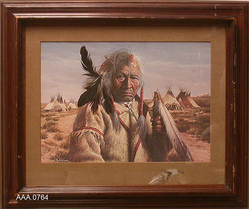 "This artifact is a framed watercolor of an old Indian with TeePees in the background.  The feathers in his hair are real.  This artifact measures 25"" x 21""."
