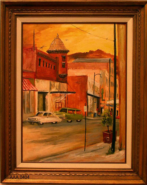 This artifact is a framed oil painting of Main Street Corona, Circa 1960 featuring the Vasels Department Store at 7th and Main Street, and other Stores.