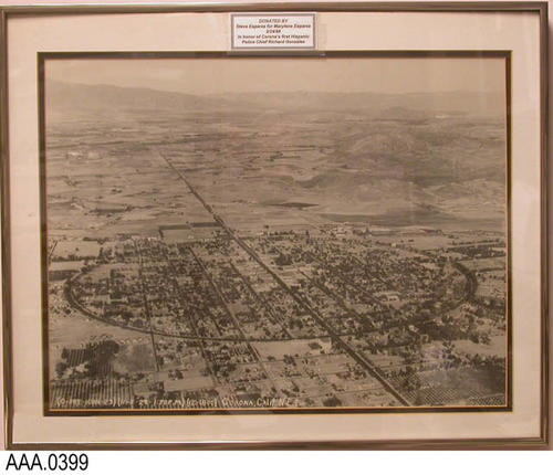 "This artifact is an aerial photo of Corona and Grand Blvd., dated 1/05/1929.  This photograph is labeled: ""Donated by Steve Esparza for Marylene Esparza - 02-24-1998 - in honor of Corona's first Hispanic Police Chief, Richard Gonzales."""