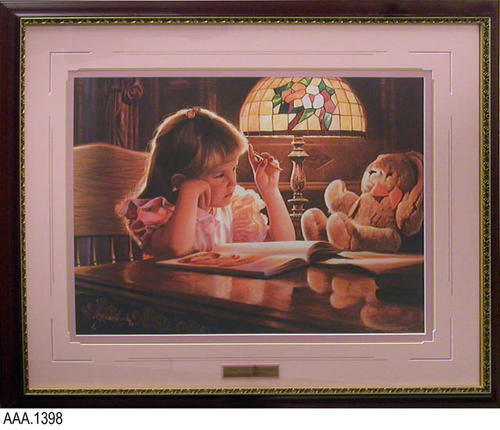 "This artifact is framed art with glass showing a little girl sitting at a table with an open book and a teddy bear with her.  Under the picture is a metal plaque that reads:  "" Teddy Bears and Dreams - Alfredo Rodriguez.""  This artifact measures  37"" (W) and 30"" (H)."