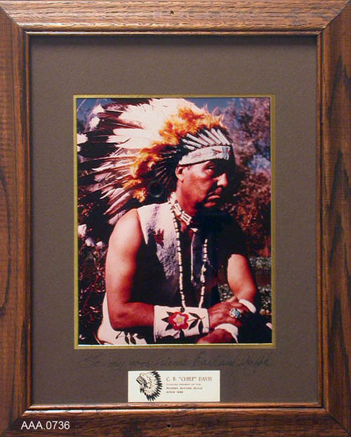 "This artifact is a color portrait photo of C. B. ""Chief"" Davis in Indian dress.  It is signed: ""To my good Friends Earl and  Ralph.""  The portrait measures 17"" x 13 1/2""."
