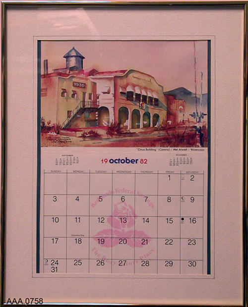 "This artifact is a framed 11"" x 7"" watercolor painting of the ""Citrus Building"" in Corona, California.  This painting is at the top of an October 1982 calendar.  The entire framed artifact measures 16 1/2"" x 20 1/8"".  The watercolor is by Mel Atwell, a retired fireman from the Pasadena, California the city where he was born May 30, 1922.  There is a short biography on the back of the artifact."