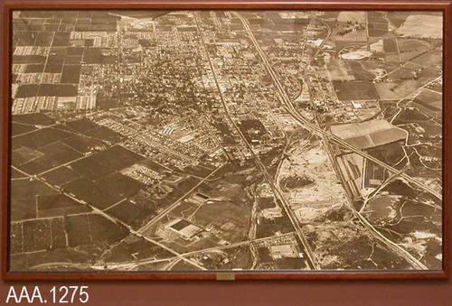 "This artifact is a framed aerial photograph showing Corona in 1967.  There is a small metal plate on the bottom of the frame with the following inscription:  ""Corona 1967 - Frame Donated - by - Kiwanis Club.""  This framed photograph measuresx 74 3/4"" (W) and 42 3/4"" (L)."