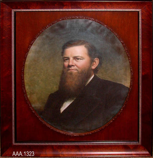 "This artifact is a framed colorized photo of George L. Joy, one of the Founding Fathers of the City of Corona.  The imprint of a rubber stamp on the back reads:  ""Clement Art Gallery - 613 1/2 S. Howard - Corona, CA 91719 - (909) 734-1855 and 737-9760 - Picture Framing - Photography - Cleaning - Restoring.""  This photo measures 22"" x 27""."