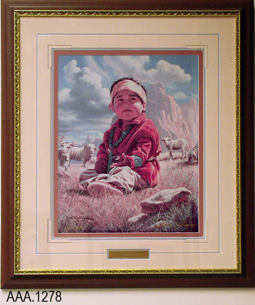 "This artifact is framed art with glass showing a Navajo child in an outdoor setting sitting on the gound.  Several sheep are in the background.  Under the picture is a metal plaque that reads:  "" Little Navajo Shepherd - Alfredo Rodriguez.""  This artifact measures  25 3/4"" (W) and 29 3/4"" (H)."
