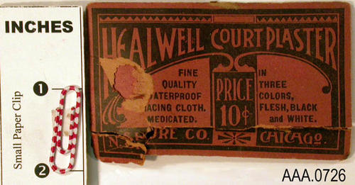 "This artifact consists of a small envelope that holds samples of Healwell Court Plaster in three colors:  Flesh, Black, White.  The text on the envelope reads:  ""Healwell Court Plaster, 10 cents, three colors, flesh, black, white.  Fine quality [next word missing] cloth medicated."""