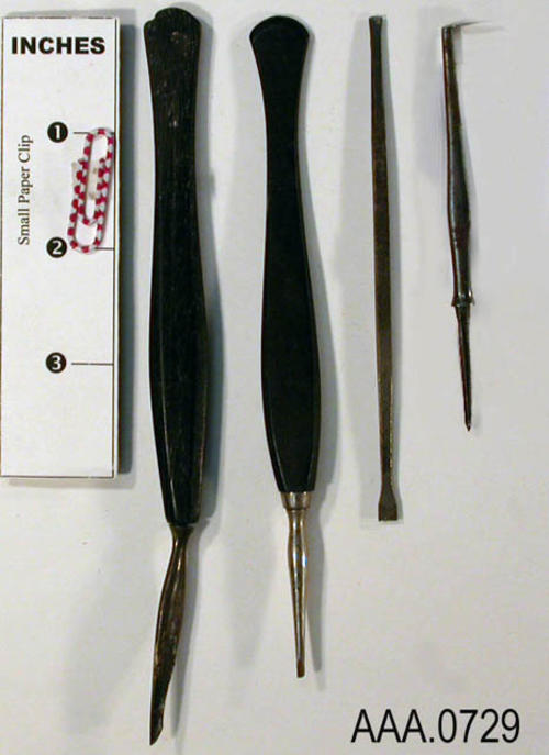 This artifact collection consists of four hand tools used in the practice of denistry.  Their exact use is unknown. Donor's Remarks:  This equipment belonged to R. A. Todd, D.D.S., who had dental rooms in the Burton Building in 1905.  Dr. Todd was listed in the 1911 city directory as practicing in the Todd Building.