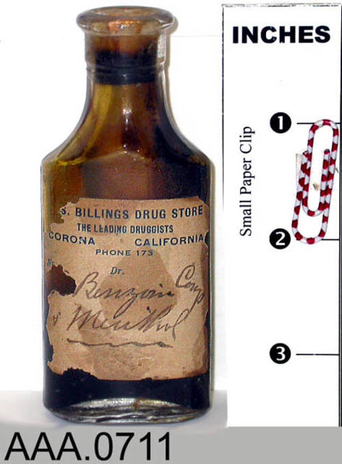 This artifact is a bottle of benzoin compound and menthos from Billings Drugstore in Corona, CA. Donor's Remarks:  This equipment belonged to R. A. Todd, D.D.S., who had dental rooms in the Burton Building in 1905.  Dr. Todd was listed in the 1911 city directory as practicing in the Todd Building.