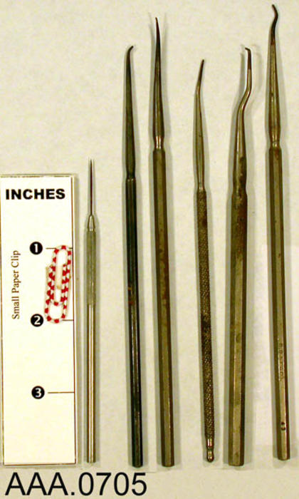 This artifact collection consists of six dental picks. Donor's Remarks:  This equipment belonged to R. A. Todd, D.D.S., who had dental rooms in the Burton Building in 1905.  Dr. Todd was listed in the 1911 city directory as practicing in the Todd Building.