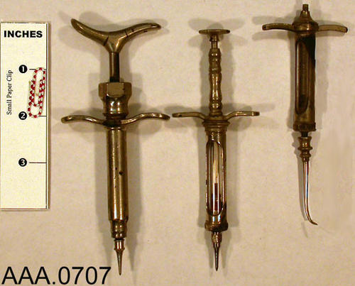 This artifact collection consists of three dental syringes. Donor's Remarks:  This equipment belonged to R. A. Todd, D.D.S., who had dental rooms in the Burton Building in 1905.  Dr. Todd was listed in the 1911 city directory as practicing in the Todd Building.
