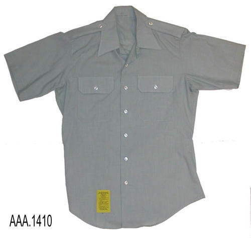 This artifact is a man's, short sleeve, shirt in gray green size 15 1/2, and is part of the Chris Harvey Eagle Scout Project:  Heroes Of Our Community - Corona, California - 2007