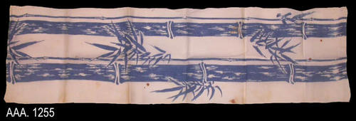 "This artifact is a blue and white, linen table runner.  This table runner has a blue bamboo design.  This runner measures 45"" x 13"".  CONDITION:  This artifact has numerous brown stains on the cloth just a little smaller than a dime."