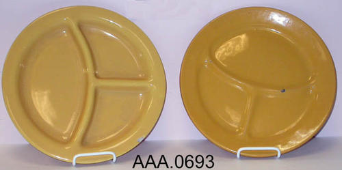 This artifact collection consists of two harvest gold, divided, cermanic dinner plates.  This plate was made in Corona.