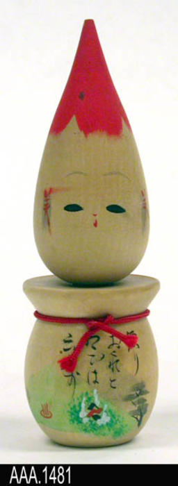 "This artifact is a small wooden, toy doll.  It is hand painted ans is similar to the Japanese Kokeshi doll MEASUREMENTS:  Diameter:  2"", Height 6 1/4""  CONDITION:  Very good. - INFORMATIONAL NOTE:  Gotsu, Japan is Corona's Sister City.  Online information about Gotsu may be seen at:  http://www.city.gotsu.lg.jp/186.html"