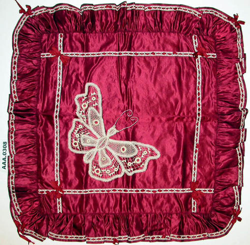 This artifact is a satin and lace pillow sham.