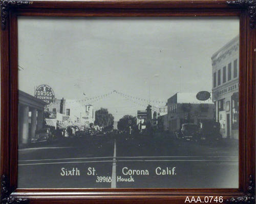 "This artifact is a B/W photograph depicting sixth Street, looking west from Main Street.  This artifact measures 15 1/2"" x 12 1/2""."