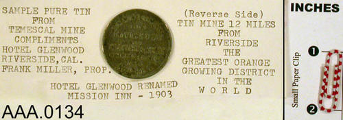 This artifact is a sample of pure tin from the Temescal Tin Mines.  Compliments of the Hotel Glenwood (Mission Inn), Riverside, California