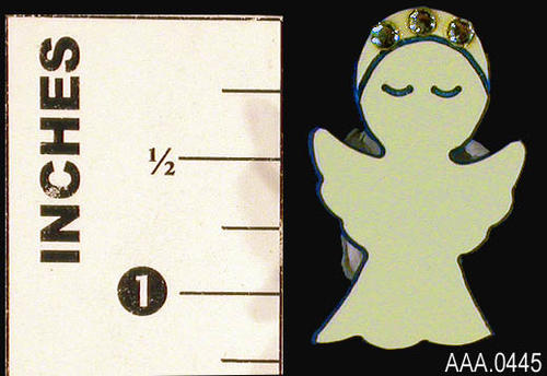 This artifact is a white angel pin with three white stones on the head.