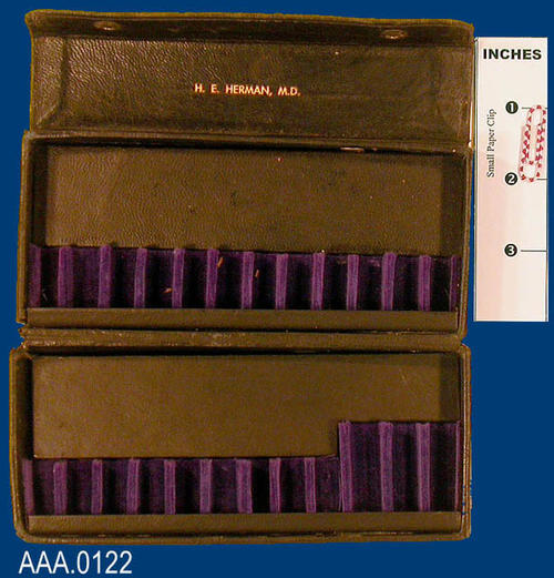 "This artifact is a black case used to carry glass viles of Medicine.  The inside of the case is inscribed with the name:  ""H. E. Herman, M.D."""