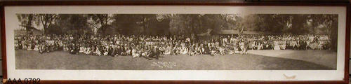 This artifact is a framed B/W photograph taken in the Corona City Park of people at the Pioneer Picnic, May 4, 1936.