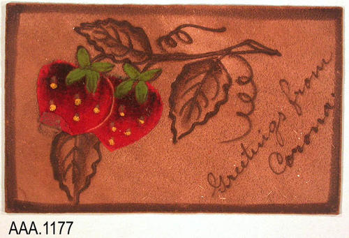 "This artifact is a leather postcard with a leaf and strawberry design printed on the front.  The text reads:  ""Greetings from - Corona.""  The back says ""Postcard"" with a box to place a stamp and lines on which to write the address."
