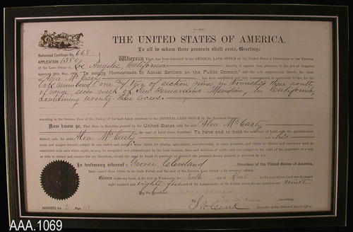 "This artifact is a copy of the Alva McCarty Homestead Certificate of Rigister as signed by President Grover Cleveland on April 10, 1885.  It is framed in a black frame that has a thin silver line edge.  This artifact measures 17"" x 11""."