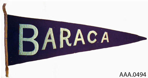 "This artifact is a pennant measuring 33 1/2"" x 18 1/2"".  The background is blue with a white base and lettering.  The lettering reads:  ""BARACA."""