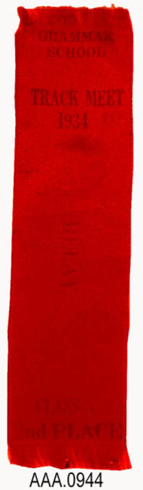 "This artifact is a red award ribbon.  It is imprinted with the following text:  ""Corona Grammar School - Track Meet - 1934 - Relay - Class A - 2nd Place.""  It measures 5 3/4"" x 1 1/2""."