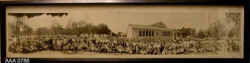 "This artifact is a framed B/W photograph of students in front of the Lincoln Elementary School - circa 1922-1923.  It measures 36"" x 9 1/4""."