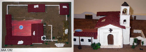 "This artifact is a model of Mission Santa Cruz located in California.  This mission, measuring 29 3/4"" (L) and 19 3/4"" (W), was made using styrofoam, cardboard, paper, dirt, wood, and plant material.  Labels identify the following buildings: ""Priests' Dwellings, Chapel, Supplies Storage, Indian Dwelling, and Soldiers Barracks.""  An identification marker reads:  ""Mission Santa Cruz - Niko Weiss - El Cerrito (This would be El Cerrito Middle School in Corona)."""