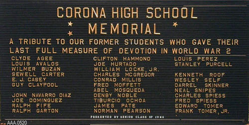 "This artifact is a sign with gold letters that read:  ""Corona High School Memorial.""  On this sign is the list of names of the thirty-one student who were from CHS that died in WWII. Donor's Remarks:  Sponsored by the Class of 1946."