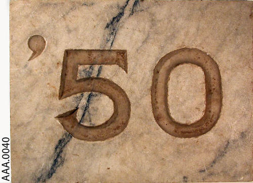 "This artifact is a  12"" by 9"" marble slab with the class year '50 on it."