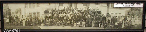 "This artifact is a framed B/W photograph of the students of Corona Jr. Highschool - 1924.  This framed photo measures 29 1/4"" x 6 3/4""."