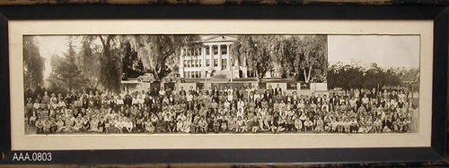 "This artifact is a black framed photograph--no glass--of the 1935-1936 Jr. High class.  There is a 15 1/4"" x 3 5/8"" inset of the front of the Jr. High School.  The framed photograph measures 34 1/2"" x 12 5/8""."