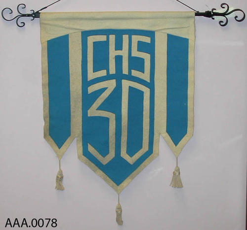 This artifact is a 1930 Corona High School Banner with a black iron hanger.  CONDITION:  This banner is in excellent condition.