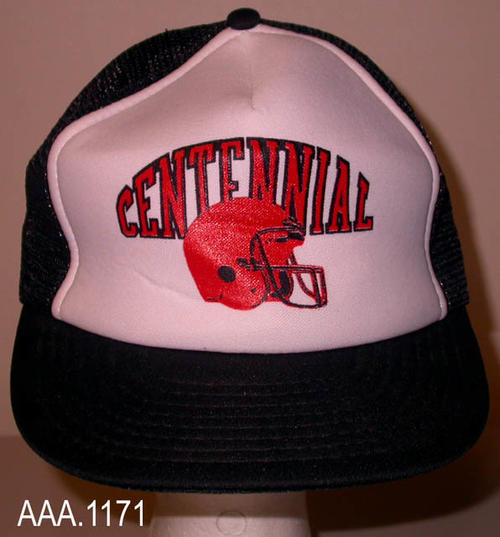 "This artifact is a one-size-fits-all baseball cap from Centennial Highschool. The cap is black and whte with the following logo on the front:  ""Centennial"" over a red football helmet."