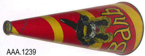 "This artifact is a striped, red and yellow megaphone with a charging panther (animal drawing) and the word ""Barb"" in yellow.  The megaphone was used by the Corona High School cheerleaders c. 1960-61.  This is one of five megaphones used by the cheerleading squad.  This megaphone measures 36 1/2"" (L), and the cone measures 2 1/2"" (at the mouth) to 12 1/2"" and the opening on the other end."