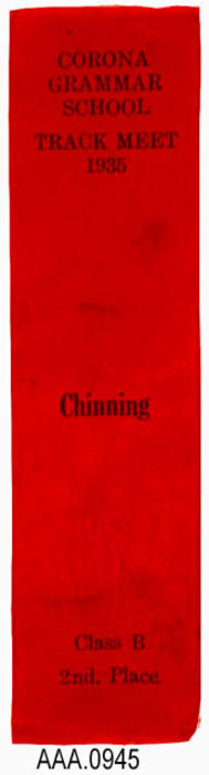 "This artifact is a red awards ribbon.  The text imprinted on the ribbon reads as follows:  ""Corona Grammar School - Track Meet - 1935 - Chinning - Class B - 2nd, Place"""