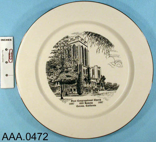 "This artifact is a commerative plate.  It has the picture of the ""First Congregational Church - 1887 - 809 Romona - 1987 - Corona, California.""  On the back of the plate is the history of the church and a list of the pastors from 1887-1982."