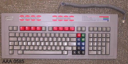 This artifact is a grey, standard, computer keyboard serial # 3420299 with an attached cord. The keyboard was part of the Library's first digital catalog.