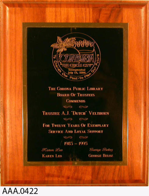 This artifact is a plaque from the Corona Public Library Board of Trustees for twelve years of service 1983-1995.