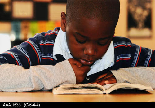 "This is a color photo mounted on foamcore.  It shows a a young boy reading alone.  The photo was used for the promotion of reading.  MEASUREMENTS:  10 7/8"" X 18 3/4"" X 3/16"", CONDITION:  Excellent, COPIES:  1"
