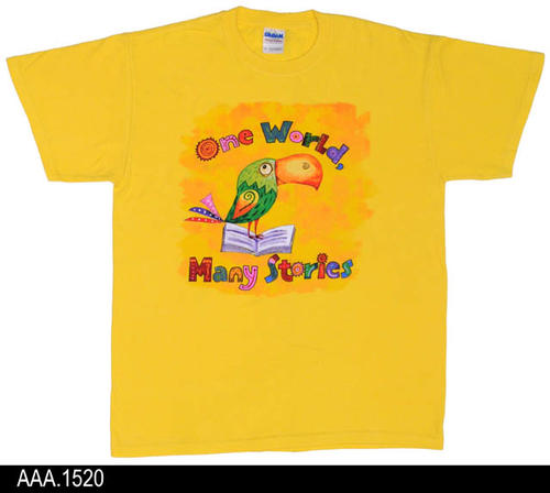 "This artifact is a yellow, adult size M, T-Shirt with a multi-color graphic on the front.  Text with the graphic reads:  ""One World, Many Stories."""