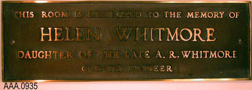 "This artifact is a Ceremonial Artifact.  It is a brass plaque which hung in the Corona Carnegie Library.  It reads, ""This Room is Dedicated to the memory of Helen Whitmore daughter of the late A. R. Whitmore, Corona Pioneer.""  Miss Whitmore was a teacher and taught in Corona.  She lost her life by drowning in Big Bear lake on Friday, September 1, 1939, when the boat in which she was sailing capsized"