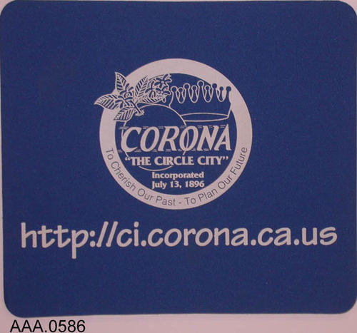 "This artifact is a blue mousepad with white highlights and the city logo.  The following text also appears:  ""http://ci.corona.ca.us (This is an incorrect URL)"""