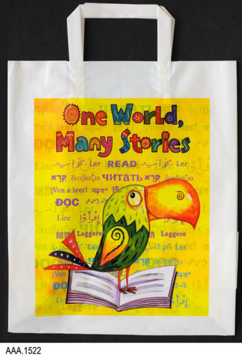 "This artifact is a white plastic bag with a handle used in the Reading Incentive Program.  The text on both sides of the bag reads:  ""One World, Many Stories.""  The graphic is a colorful bird (Toucan) standing on a book:  MEASUREMENTS:  16"" (Bottom to top of handle), x 11"", CONDITION:  Excellent, QUANTITY:  1."