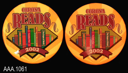 "This artifact collection consists of two identical ""Corona Reads 2002"" pins. This pin has rays of light and dark yellow.  The purple text reads:  ""Corona Reads - in the middle a ""shelf of books"" - 2002.""  John Steinbeck was the selected author for this year.   Three of his book titles are featured on the books on the shelf.  They are:  ""Tortilla Flat, The Red Pony, and The Grapes of Wrath.""  CONDITION:  These pins are in excellent condition."