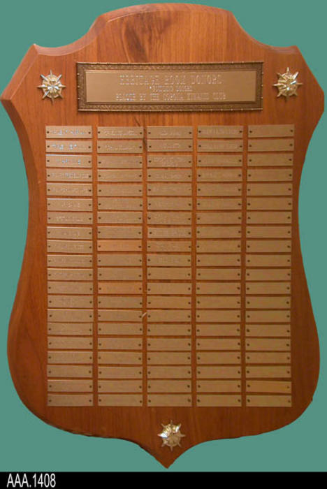 "This artifact is a plaque displaying the Founding Heritage Room Donors.  The plaque was given to the library by the Kiwanis Club.  The plaque displays sixty-nine donor names.  CONDITION:  This plaque is in good condition.  MEASUREMENTS:  20"" X 16"".  The plaque is shaped like a shield."